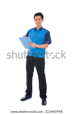 courier in blue uniform sending a package - stock photo