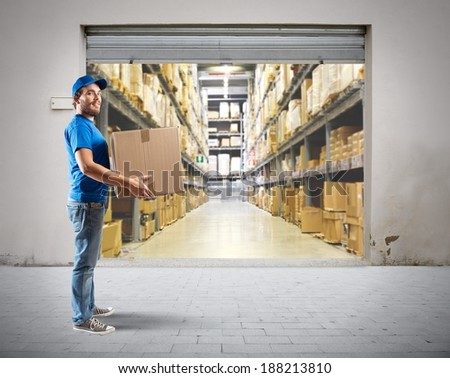 Courier to work in the warehouse logistics - stock photo
