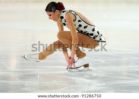 COURMAYEUR, ITALY - DEC 17: Professional skater Carol Bressanutti performs free skating at the 2011-12 Italian national figure ice skating Championship on December 17, 2011 in Courmayeur, Italy. - stock photo