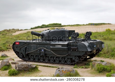 COURSEULLES SUR MER, FRANCE - MAY 31: A memorial AVRE Churchill tank dedicated to the landings in France on D-Day stands above the Canadians Juno beach on May 31, 2014 in Courseulles sur Mer