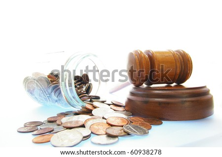 court gavel and coin jar, on white - lawsuit or divorce concept - stock photo