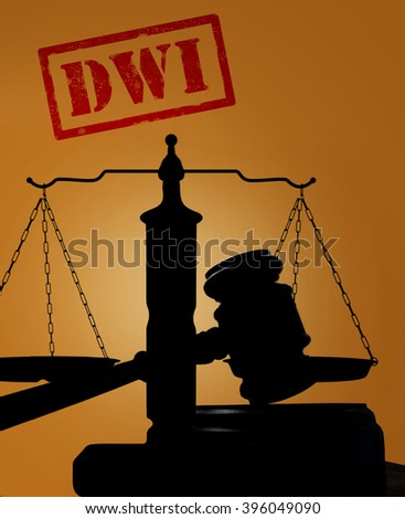 Court gavel and scales with DWI text -- Driving while intoxicated concept