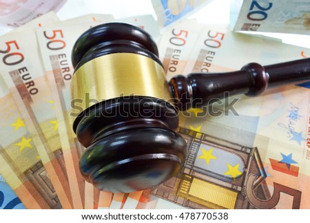 Court gavel on assorted Euro bills