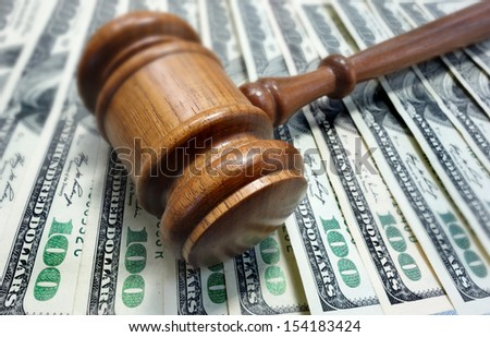 court gavel on $100 bills - legal concept                                - stock photo