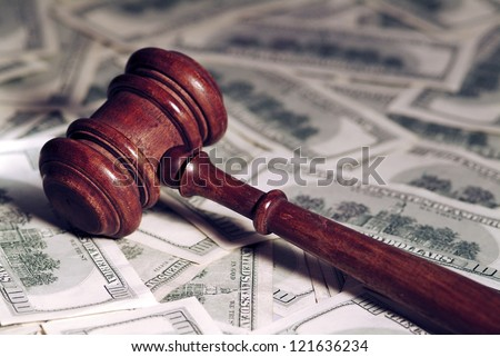 Court gavel on money background.Shallow focus.