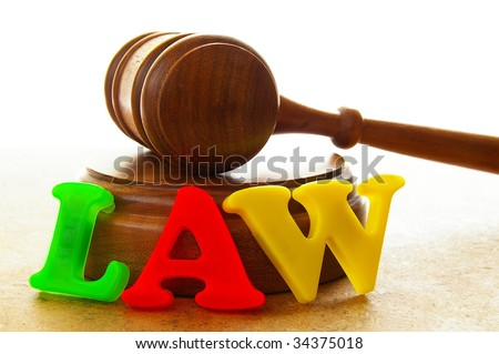 "court gavel with play letters spelling ""law"""