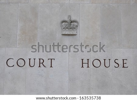 Court House sign carved in the wall - stock photo