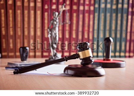 Court Judge's gavel, Themis - the goddess of justice, notary public stamper and law codes in the background. Law office. Law concept.  - stock photo