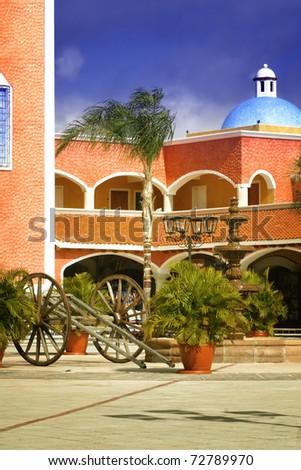 Court yard of a Hacienda in a tropical resort - stock photo