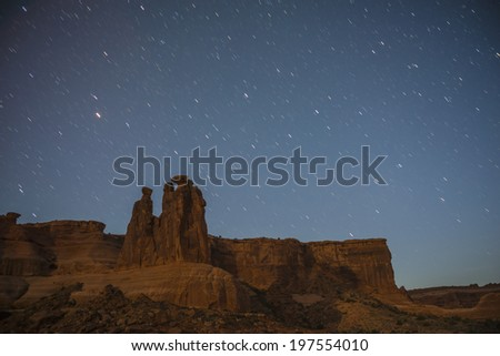 Courthouse Towers at night against beautiful starry sky - stock photo