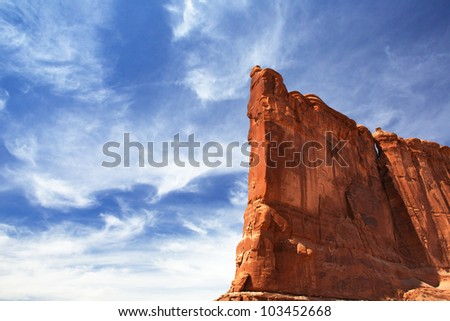 Courthouse Towers Ridge in Arches National Park with dramatic Blue Sky - stock photo