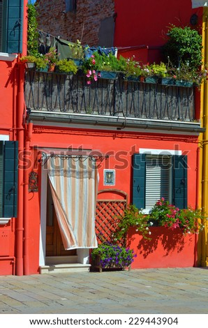 Courtyard between colorful houses on the famous island Burano, Venice