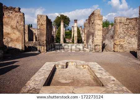 Courtyard of a ruined villa at the ancient Roman city of Pompeii - stock photo