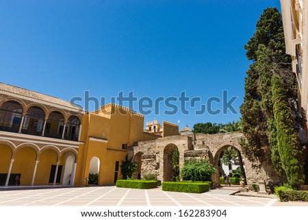 Courtyard of Royal Alcazar in Seville, Andalusia, Spain - stock photo