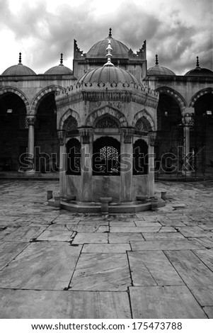 Courtyard of Yeni Cami, The New Mosque in Istanbul. Black and white shot - stock photo