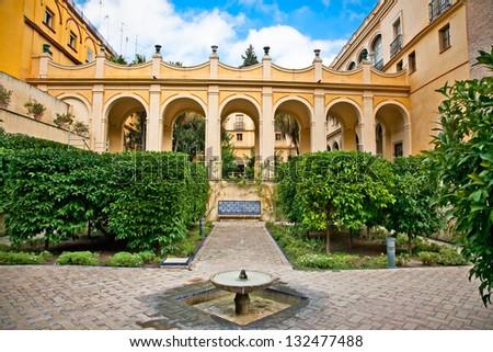 Courtyard with fontain of Casa de Pilatos, Seville, Andalusia, Spain - stock photo