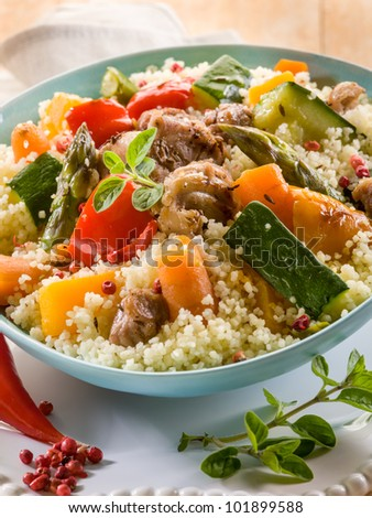 cous cous with meat  and vegetables - stock photo