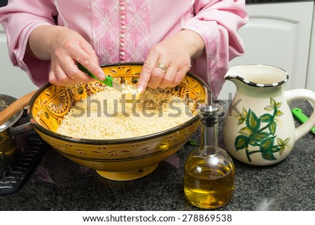 Couscous being prepared by a Moroccan immigrant woman in her modern European kitchen - stock photo