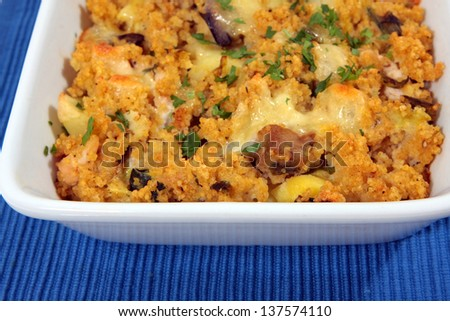 Couscous casserole with vegetables and chicken - stock photo