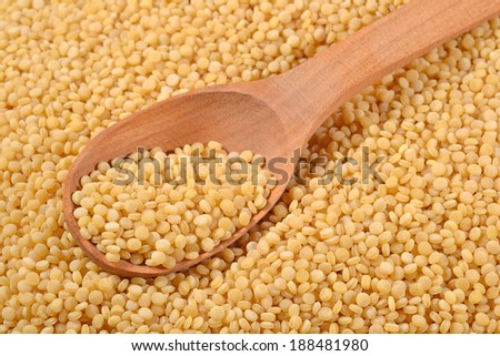 Couscous in a wooden spoon