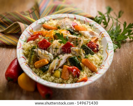 couscous with fish and vegetables, selective focus
