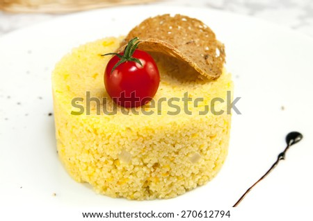 couscous with grilled vegetables on a table in a restaurant - stock photo