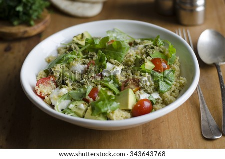 Couscous with mozzarella, tomatoes and avocado - stock photo