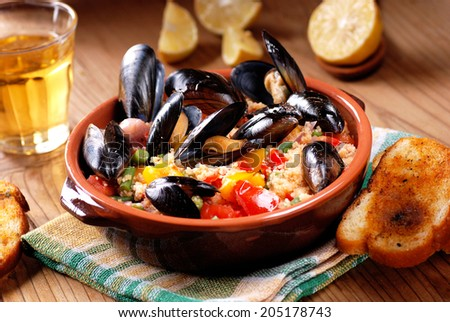 couscous with mussels and vegetables in earthenware