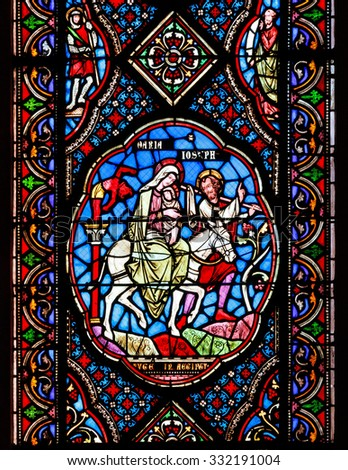 COUTANCES, FRANCE - SEPTEMBER 8 2015: Stained glass windows depicting Mary, Joseph and baby Jesus in the Coutances Cathedral in Normandy, France - stock photo