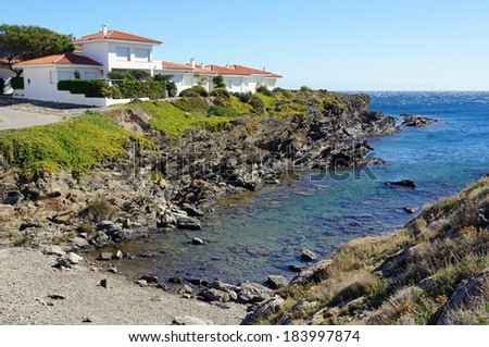 Cove with waterfront villa in the coast of the Mediterranean sea, Cadaques, Catalonia, Costa Brava, Spain - stock photo
