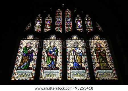 Coventry in West Midlands, England. Stained glass in the medieval Holy Trinity Church. Saint evangelists: Matthew, Mark, Luke and John.