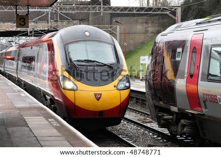 COVENTRY - MARCH 12: Pendolino train of Virgin Trains on March 12, 2010 in Coventry, UK. Pendolinos are notable for returning 17% of the power the use to the power grid (enough for 15,000 homes/year). - stock photo