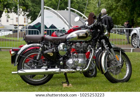 COVENTRY, UK - JUNE 4: A retro styled Royal Enfield motorcycle stands on display for the public to view during the MotoFest weekend event on June 4, 2017 in Coventry