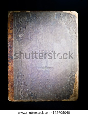 Cover of the old book on black background - stock photo