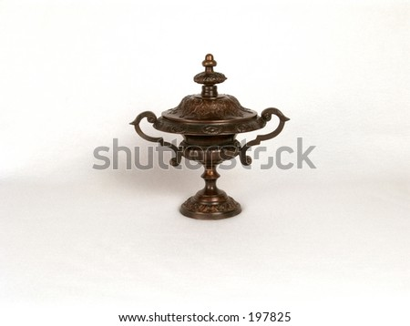 covered brass dish with handles - stock photo