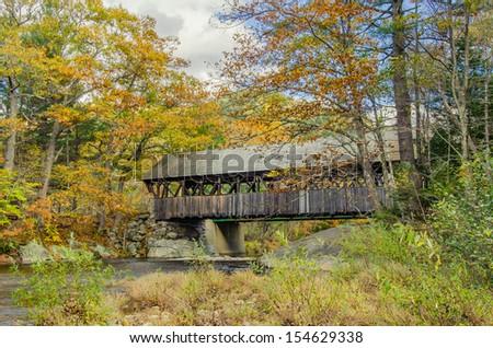 Covered Bridge and Autumn Colours - stock photo