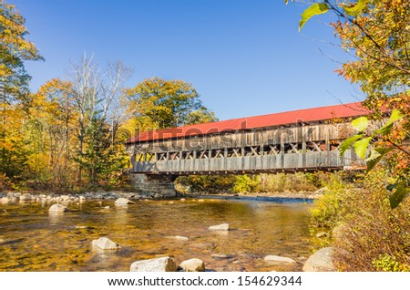 Covered Bridge and Fall Colors in New Hampshire - stock photo