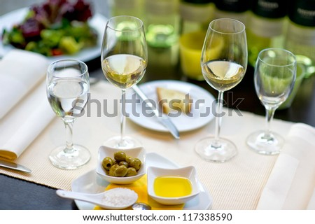 Covered dining table with wine glasses - stock photo