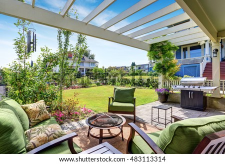 Covered Patio Area With Outside Chairs In The Backyard Garden. House  Exterior. Northwest,