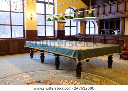 Covered pool table in the billiard room - stock photo