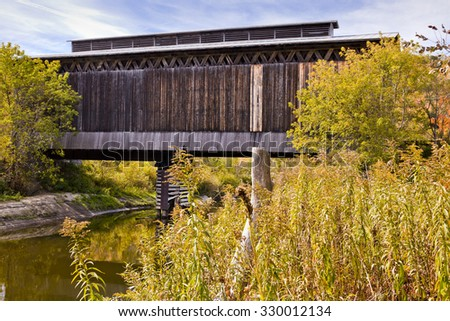 Covered Railroad bridge in Vermont - stock photo