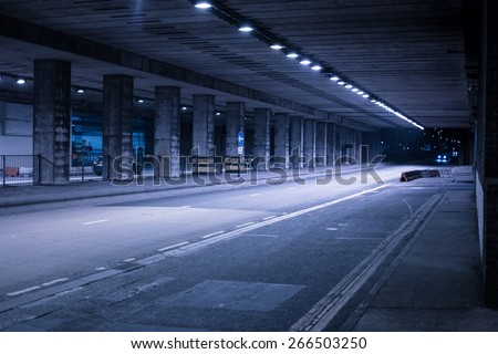 Covered Urban Street Illuminated in Cool Blue Light at Night - stock photo