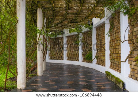 Covered walkway in the park - stock photo