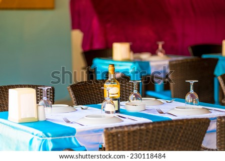 covered with for the guests tables in the restaurant - stock photo