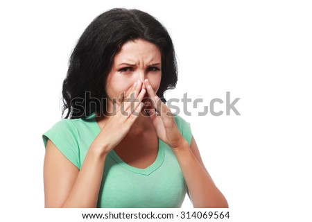Covering her nose after a bad smell - stock photo