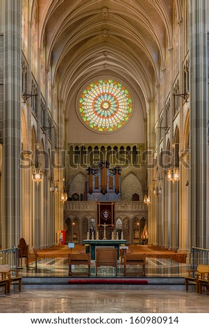 COVINGTON, KENTUCKY - OCTOBER 28: Circular stained glass window in the back of  the St. Mary's Cathedral Basilica of the Assumption on October 28, 2013 in Covington, Kentucky - stock photo