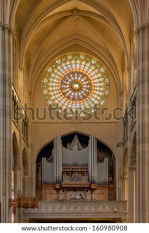 COVINGTON, KENTUCKY - OCTOBER 28: Pipe organ under circular stained glass window of the St. Mary's Cathedral Basilica of the Assumption on October 28, 2013 in Covington, Kentucky - stock photo