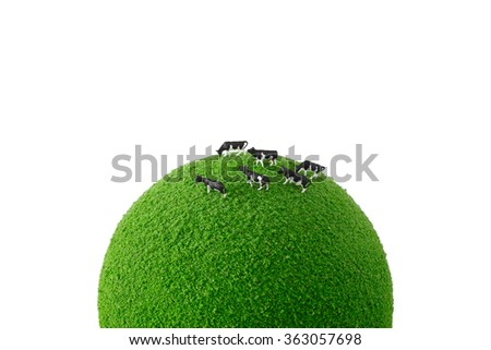 cow on  the green globe - stock photo