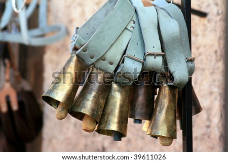 Cowbells in a country market, Spain
