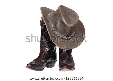 Cowboy boots and hat isolated with clipping path - stock photo